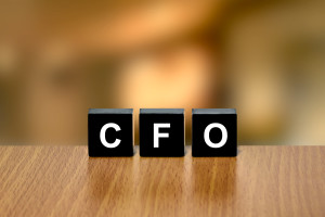 CFO or chief financial officer on black block with blurred background